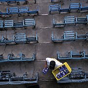 MEXICO CITY, MEXICO: A vendor makes his way through the mostly empty seats at the stadium in Mexico City during a Mexican League Baseball game. Soccer is still the most popular sport.