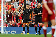 Burnley Goalkeeper Nick Pope receives a yellow card from referee Roger East. Premier League match, Liverpool v Burnley at the Anfield stadium in Liverpool, Merseyside on Saturday 16th September 2017.<br /> pic by Chris Stading, Andrew Orchard sports photography.