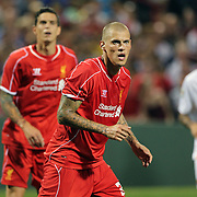 Martin Skrtel, (centre), and Daniel Agger, Liverpool, in action during the Liverpool Vs AS Roma friendly pre season football match at Fenway Park, Boston. USA. 23rd July 2014. Photo Tim Clayton
