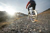 Young man mountain biking in the Sierra Nevada Mountains. Lake Tahoe, CA
