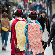 Geisha walking in the Higashiyama district of Kyoto.