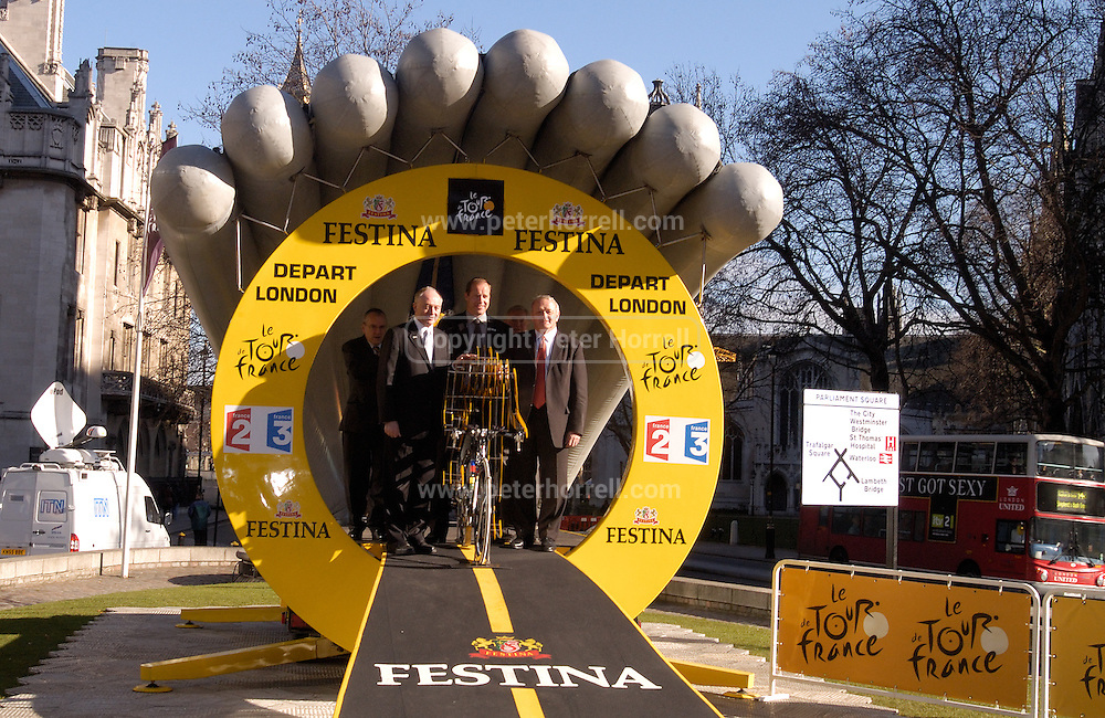 Ken Livingstone, Christian Prudhomme and Jean Marie Leblanc stand on the Time Trial start gate outside the Queen Elizabeth 2 Conference Centre on Thursday 9th February 2006.