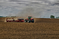 Farmers hit the fields with large machinery including tractors, disc, plows, planters and sprayers as they get a late start on the season due to unseasonable weather in central Illinois