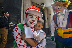 October 24, 2016 - Sao Paulo, Sao Paulo, Brazil - A clown hugs a child during a protest with  a group of clowns in the old center of Sao Paulo. They are against bad clowns scaring people. The wave of evil clowns started in the US and has spread to many countries. (Credit Image: © Cris Faga via ZUMA Wire)