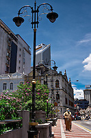 The contrast of old colonial shophouses are a stark contrast to the Malay styled Menara Maybank building in Kuala Lumpur.
