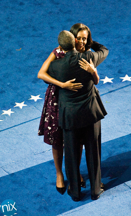 President Barack Obama hugs his wife Michelle during the last night of the Democratic National Convention at Time Warner Cable Arena in Charlotte Thursday, Sept. 6, 2012. (Photo by James Nix)