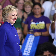 Democratic presidential candidate Hillary Clinton walks onstage during her introduction at a campaign stop at the Frontline Outreach Center in Orlando, Fla., on Wednesday, Sept. 21, 2016. (Alex Menendez via AP)