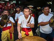 "08 FEBRUARY 2016 - BANGKOK, THAILAND: Drummers for a lion dance troupe performs in Bangkok's Chinatown district during the celebration of the Lunar New Year. Chinese New Year is also called Lunar New Year or Tet (in Vietnamese communities). This year is the ""Year of the Monkey."" Thailand has the largest overseas Chinese population in the world; about 14 percent of Thais are of Chinese ancestry and some Chinese holidays, especially Chinese New Year, are widely celebrated in Thailand.       PHOTO BY JACK KURTZ"