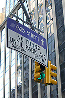 21 NOV 2003, NEW YORK/USA:<br /> Eine Gruene Verkehrsampel und Verkehrsschilder vor den Hochhauskulissen  von Manhatten, New York<br /> IMAGE: 20031121-02-033<br /> KEYWORDS: Taxi, Strasse, grüne