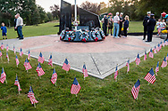 Washingtonville, N.Y. - People gather at the Washingtonville 5 Firefighters World Trade Center Memorial for a candlelight service on Sept. 11, 2017. The Memorial was built in honor of five FDNY firefighters from Washingtonville and the many others who lost their lives on September 11, 2001 in the World Trade Center terrorist attack.