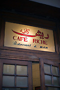 The sign above the door of Cafe Riche, Cairo, Egypt