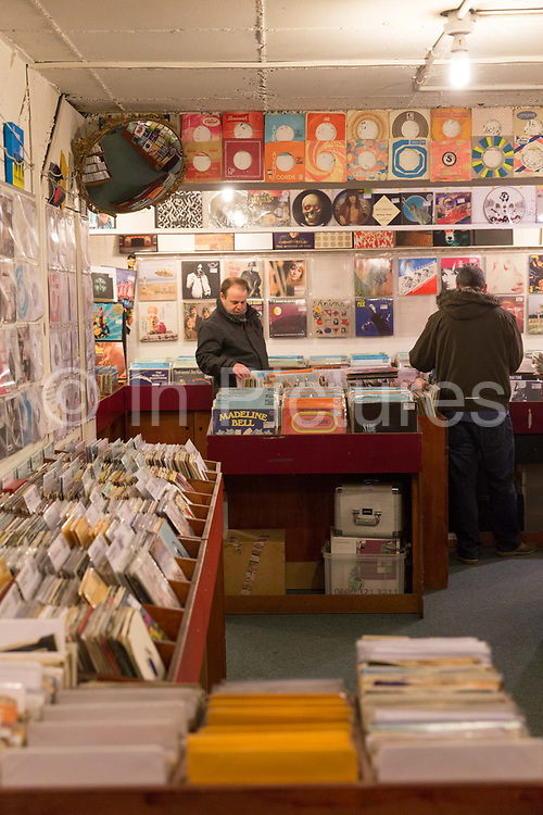 Two men searching for new music at the Flashback record shop in Islington on the 27th March 2018 in North London, United Kingdom.