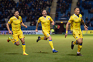 Bristol Rovers forward Jonson Clarke-Harris (19) (right) scores a goal (0-1) and celebrates with team mates during the EFL Sky Bet League 1 match between Gillingham and Bristol Rovers at the MEMS Priestfield Stadium, Gillingham, England on 12 March 2019.
