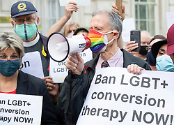 """LGBT+ protestors including Jayne Ozanne, Rev Colin Coward and Peter Tatchell lead an anti Conversion Therapy demonstration outside The Cabinet Office, Whitehall, London, Great Britain <br /> 23rd June 2021 <br /> <br /> Members of the LGBT+ community, including Peter Tatchell tell the Government to """"stop dithering"""" over its promised ban on LGBT+ conversion therapy. It pledged to outlaw conversion therapy practices in the UK in 2018. <br /> <br /> <br /> Photograph by Elliott Franks"""