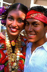 Stock photo of a man and woman in traditional native clothing at the International Festival in downtown Houston Texas