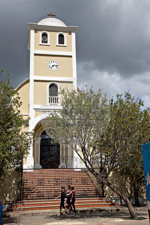 Spanish Colonial style church Iglesia de Parroquia San Jose de la Montana in the Plaza de la Revolucion in Lares, Puerto Rico. Lares is where the 1868 revolt began.