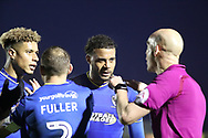 AFC Wimbledon striker Lyle Taylor (33), AFC Wimbledon midfielder Tom Soares (19) and AFC Wimbledon defender Barry Fuller (2) talking to the ref during the EFL Sky Bet League 1 match between AFC Wimbledon and Blackpool at the Cherry Red Records Stadium, Kingston, England on 20 January 2018. Photo by Matthew Redman.