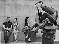 """Relaxing with one of the sculptures of the installation on the roof  of the Metropolitan Museum of Art """"The Theater of Disappearance"""" by Adrián Villar Rojas."""