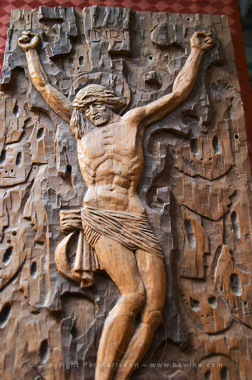 A wood carving of Christ on the crucifix. Berat lower town. Albania, Balkan, Europe.