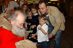 Actor JASON DONOVAN and his son ZAC meet Father Christmas at a children's party in aid of the charity Over The Wall held at Fortnum & Mason, Piccadilly, London before a gala premiere of the new musical Mary Poppins at The Prince of Wales Theatre, Old Compton Street, London W1<br /><br />NON EXCLUSIVE - WORLD RIGHTS