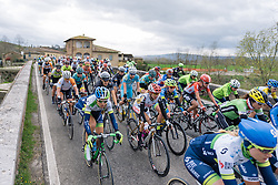 Peloton stream into Ponte D'Arbia - 2016 Strade Bianche - Elite Women, a 121km road race from Siena to Piazza del Campo on March 5, 2016 in Tuscany, Italy.