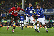 Paul Pogba of Manchester United looks to shoot as Ashley Williams of Everton looks to block. Premier league match, Everton v Manchester United at Goodison Park in Liverpool, Merseyside on Sunday 4th December 2016.<br /> pic by Chris Stading, Andrew Orchard sports photography.