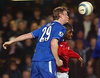 Photo: Daniel Hambury, Digitalsport<br /> Chelsea v West Bromwich Albion.<br /> FA Barclays Premiership.<br /> 15/03/2005.<br /> Chelsea's Robert Huth gets ahead of West Brom's Kanu