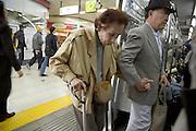 elderly couple entering a train Tokyo Japan