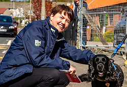Pictured: Ruyth Davidson and constituent's dog Sasha<br /><br />Douglas Ross was Joined by Ruth Davidson and candidate Gordon Lindhurst in Colington Mains to post leaflets asking for the peach party vote to be made in favour of the Scottish Conservatives. Ger Harley | EEm 30 April 2021