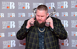 Rag 'n' Bone Man aka Rory Graham with the Critic's Choice and Best British Breakthrough Artist Award's in the press room during the Brit Awards at the O2 Arena, London. PRESS ASSOCIATION Photo. Picture date: Wednesday February 22, 2017. See PA story SHOWBIZ Brits. Photo credit should read: Ian West/PA Wire. Editorial Use Only - No Merchandising