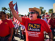 05 OCTOBER 2013 - PHOENIX, ARIZONA: A man cheers a speaker during an immigration reform rally in Phoenix. More than 1,000 people marched through downtown Phoenix Saturday to demonstrate for the DREAM Act and immigration reform. It was a part of the National Day of Dignity and Respect organized by the Action Network.   PHOTO BY JACK KURTZ