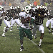 Marshall running back Travon Van (7) eludes Central Florida cornerback Josh Robinson (20)during an NCAA football game between the Marshall Thundering Herd and the Central Florida Knights at Bright House Networks Stadium on Saturday, October 8, 2011 in Orlando, Florida. (Photo/Alex Menendez)