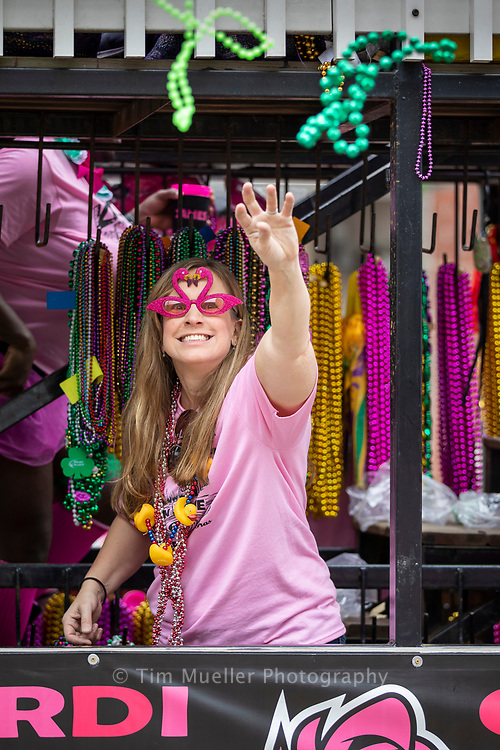 Nancy Callaway of the Krewe of Khaos throws beads during the Spanish Town Mardi Gras parade in Baton Rouge, La. Saturday, March 3, 2019.