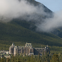 The Banff Springs Hotel rises above a forest in Alberta, Canada's Banff National Park.