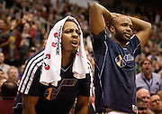 Jazz guards Randy Foye and Jamaal Tinsley, left and right, react to a negative call during the first half of the NBA basketball game between the Utah Jazz and the Golden State Warriors at Energy Solutions Arena, Wednesday, Dec. 26, 2012.