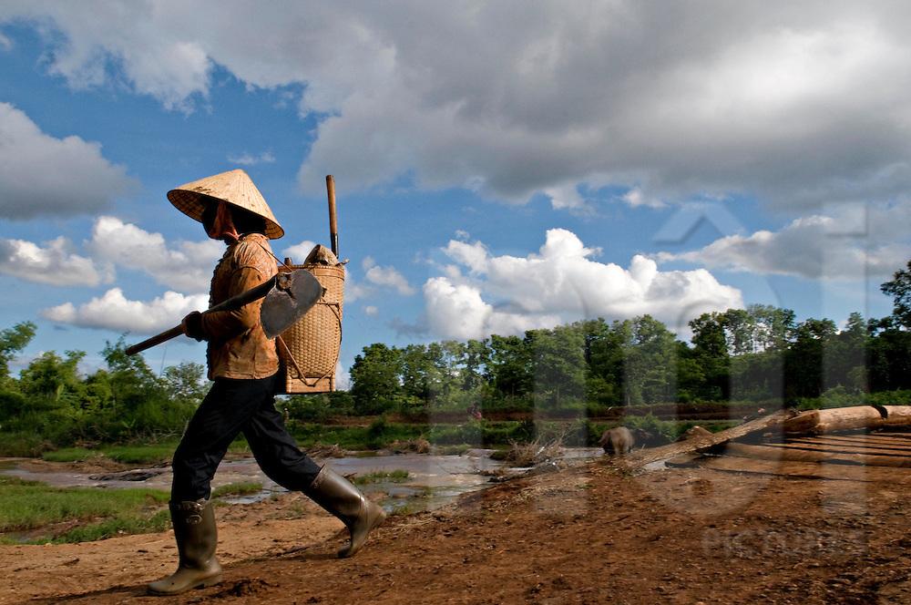 Silhouette of an anonymous vietnamese farmer woman walking back home, Pleiku area, Vietnam, Southeast Asia