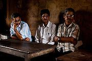 Village Child Protection Committee (VCPC) members (L-R) Mahanan Acharya (40), Durga Prasad Bhatarai (46), and Harsha Bahadur Pun (63) speak of their work and the issues of child marriage  in Lekhapharsa vilage, Surkhet district, Western Nepal, on 30th June 2012. The VCPC works to intervene in child marriages such as the case of Pramila and is supported by Save the Children and local NGO Safer Societies. In Surkhet, StC partners with Safer Society, a local NGO which advocates for child rights and against child marriage. Photo by Suzanne Lee for Save The Children UK