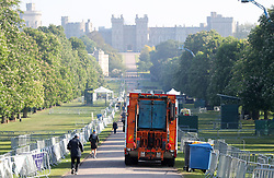 A bin lorry makes its way down the Long Walk in Windsor, as the clean-up continues after the royal wedding.