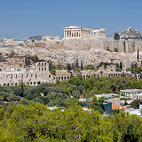 Athens. Greece. View of the sacred rock of Athens, the Acropolis which rises 100 metres above the city as the undisputed symbol of the emergence of western civilization.  Crowning its summit is the magnificent Parthenon Temple, dedicated to the goddess Athena.