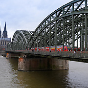 Train on Hohenzollern bridge and Cologne Cathedral, Germany
