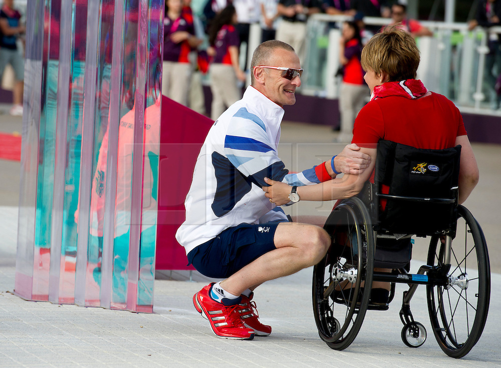 © Licensed to London News Pictures. 28/08/2012, Paralympic Athletes Village, Olympic Park, London. Baroness Tanni Grey Thompson and Paralympic Chef de Mission Craig Hunter share a moment during the ceremony to welcomeTeam GB Paralympic participants into the athletes village today ahead of the official opening ceremony, which is due to start on the 29 Aug 12.   Photo credit : Alison Baskerville/LNP