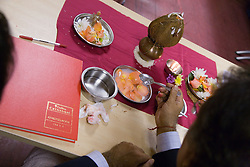Performing the Chopda Puja blessing of business books at Diwali; Festival of Light,