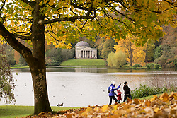 © Licensed to London News Pictures. 05/11/2016. Stourton, UK.  People out enjoying the autumn colours at Stourhead Gardens in Wiltshire today, 5th November 2016.  Photo credit: Rob Arnold/LNP