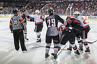 KELOWNA, BC - JANUARY 4: Referee Chris Crich attempts to restore order after the Kelowna Rockets and the Vancouver Giants get in one another's faces during second period at Prospera Place on January 4, 2020 in Kelowna, Canada. (Photo by Marissa Baecker/Shoot the Breeze)