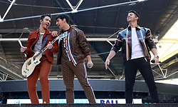 Kevin Jonas, Joe Jonas and Nick Jonas of Jonas Brothers on stage during Capital's Summertime Ball. The world's biggest stars perform live for 80,000 Capital listeners at Wembley Stadium at the UK's biggest summer party.