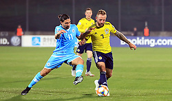 San Marino's Manuel Battistini (left) and Scotland's Johnny Russell battle for the ball during the UEFA Euro 2020 Qualifying, Group I match at the San Marino Stadium, Serravalle.
