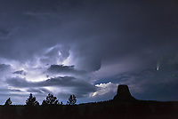 I couldn't let NEOWISE leave without trying to capture it over Devils Tower. But this wasn't the shot I had in mind. The forecast called for mostly clear skies after earlier severe weather exited. But sometimes what actually happens is so much better than what I can imagine. This supercell popped up to the west around 10PM and the anvil quickly blocked out the comet. But then just as the storm was showing its best mothership structure during a close encounter with the tower, a hole in the clouds opened up. It was perfectly placed to reveal the comet once again for just a few minutes. It's a good thing that most of the lightning was intracloud. If bolts of lightning were jumping out they would have been too bright to expose for the comet. Every single flash highlighted or backlit a different part of the storm. While the lightning continued for most of the night, I was glad the large hail stayed away. I didn't want to test the hailproofness of my tent.