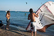 Rafina is a beach resort located on the eastern coast of Attica in Greece, just 25 miles or so from the centre of Athens. This area, a few miles south from Rafina town is a haven for windsurfers and kitesurfers due to ideal winds coming in across the Gulf of Petalion and the Aegean Sea. Strong and constant winds draws so many surfers it looks like they may always be colliding, but these skilled surfers rarely ever tangle with one another.