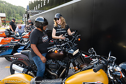 Harley-Davidson electrical engineer Elizabeth Thurman helped Eric Harjo of Okemah, OK at the Harley-Davidson test ride Pop-Up in Deadwood. It was a popular new addition for 2019 where riders could take out a Harley for a full hour on the beautiful Black Hills twisty's during the Sturgis Black Hills Motorcycle Rally. SD, USA. Friday, August 9, 2019. Photography ©2019 Michael Lichter.