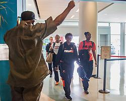 St. Thomas resident Raymond Frett welcomes his daughter Asst. Coach La'Keisha Frett back home.  The ladies of the University of Virginia's Basketball Team arrive for the Paradise Jam Tournament  in St. Thomas at Cyril E. King Airport.  24 November 2015.  © Aisha-Zakiya Boyd